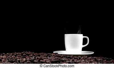 cup of coffee with smoke on roasted beans seed and black...