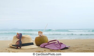flip flops, sunglasses and straw hats on the beach. Relax concept (copy space)