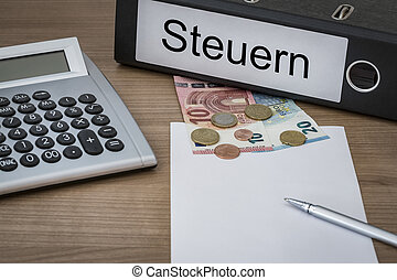 Steuern written on a binder - Steuern (German Taxes) written...