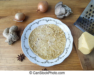 Tortilla on plate with Oyster mushrooms, onion and ginger...