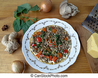 Cooking pizza with oyster mushrooms, nettles, tomato, onion...