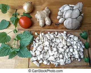 Oyster mushrooms on table, going to cook with spices pizza,...