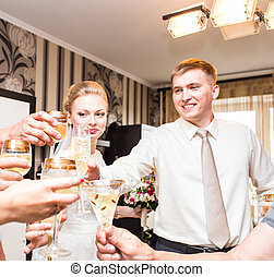Wedding guests clinking glasses - Wedding guests clinking...