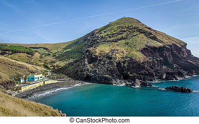 Black vulcanic sand beach at Madeira island - Wild black...