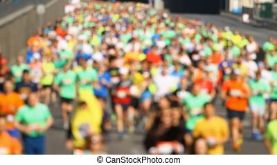 City marathon of blurred people runners