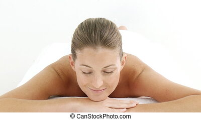 A woman relaxing in a spa center - Montage of a pretty woman...