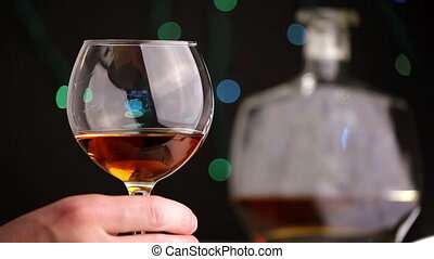 man tasting a glass of cognac