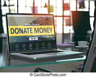 Donate Money on Laptop in Modern Workplace Background -...