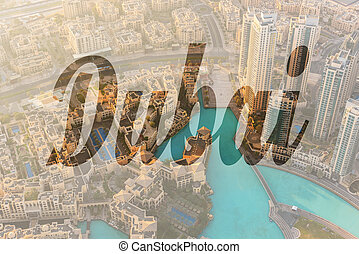 Dubai downtown morning scene - Name of city Dubai written on...