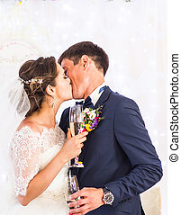 Kiss the bride and groom in their wedding day