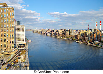 East River - aerial view. - View of East River with shadow...