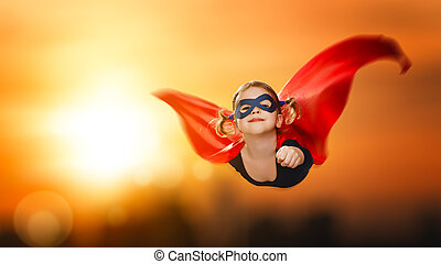 child girl superhero flying through sky at sunset