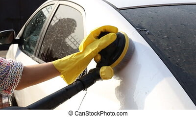 Rinsing all the soap suds off of a car