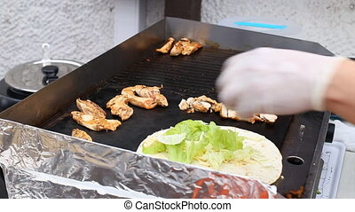 Making a chicken kabab pita wrap on a fast food restaurant...