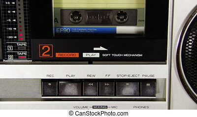 Pushing Button on the Audio Cassette Player