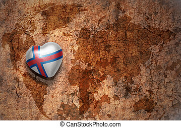 heart with national flag of faroe islands on a vintage world...