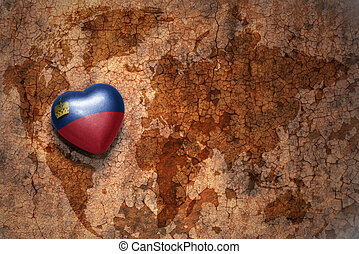 heart with national flag of liechtenstein on a vintage world...