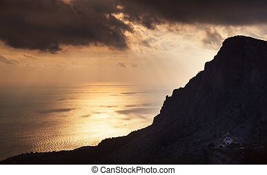 Church under a mountain at sunset - Small church under a...