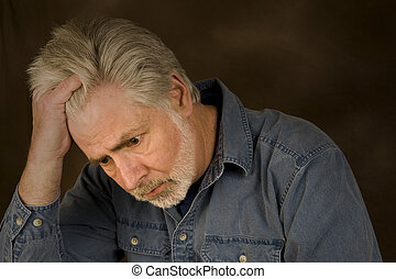 Overwhelmed - A middle-aged man with gray hair and beard...