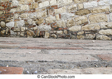 Stone wall with red bricks in like a flour or ceiling