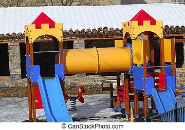 children playground park winter snow iced floor