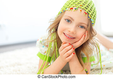 Cute girl green hat - Cute girl wearing a green hat on a...