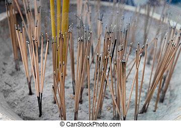 Joss Sticks Smolder on a Buddhist Altar in a temple -...
