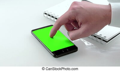 businessman hand using a smart phone in the office with chroma key, green screen, business communication with smartphone technology concept