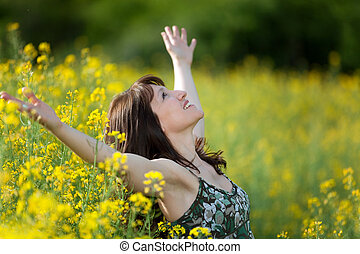 woman purity in nature - woman in a rape field breathing and...