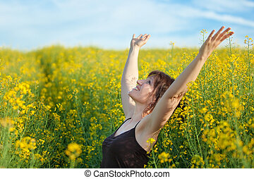 woman freedom in nature - woman enjoying spring sunlight in...