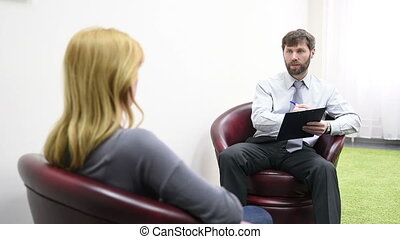 male psychologist and his female patient during therapy....