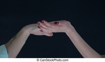 The hands of the men and women on a black background