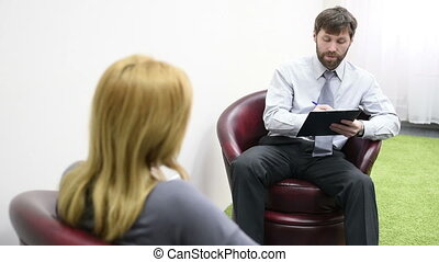 male psychologist and his female patient during therapy...
