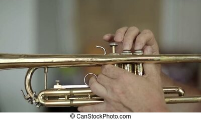 Playing the trumpet close-up HD