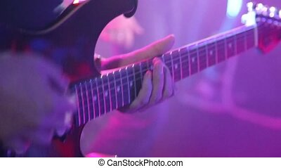 Playing on guitars close-up HD