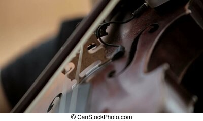 Playing the violin close-up HD