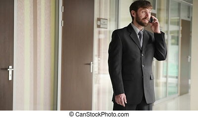 successful business man having cell telephone conversation...