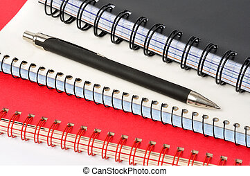 Notepads - Spiral notepads and ball pen on white background