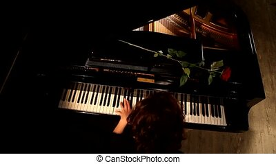 Woman Pianist Hands plays The Grand