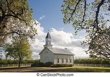 Old white rural church - Old clapboard white rural church in...