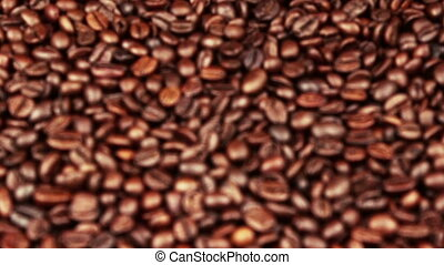 top of view of texture of roasted coffee beans with initial out of focus