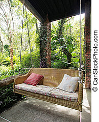Front porch swing with comfortable pillows...