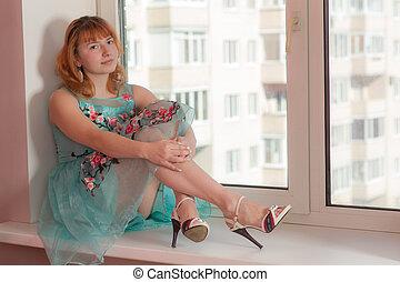 girl sitting on a window sill