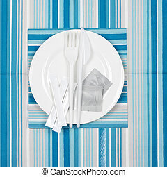 Disposable fast food set: white plate with packed toothpicks...