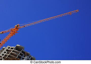 Construction crane against the blue sky building under...
