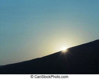 Sunset over hill or mountain