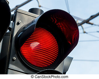 red traffic light - a traffic light on the road shows red...