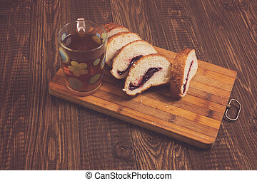 Cutted loaf and tasty tea - Tasty tea in a cup and cutted...