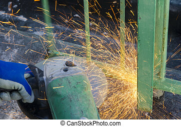 cutting a railing - workers while cutting a metal railing