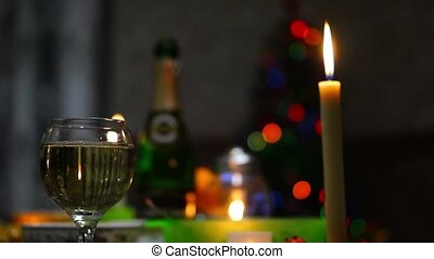 Champagne, candle and romantic Christmas night.